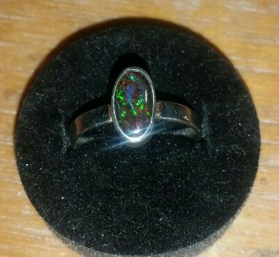 Handcrafted matrix boulder opal ring . Size 7 . Solid opal.  Natural