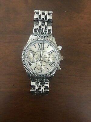 Used. Barely worn silver Michael Kors watch