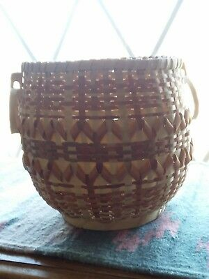 White Oak and Maple Cherokee basket by master weaver Mary Jane Lossiah.