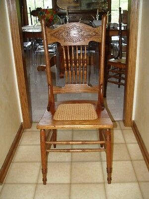 Antique oak pressed back chair cane seat