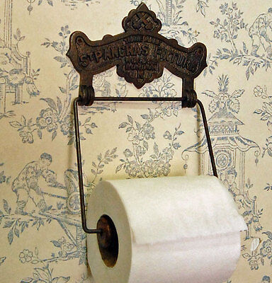 Traditional antique St Pancras design wall mounted toilet roll holder.