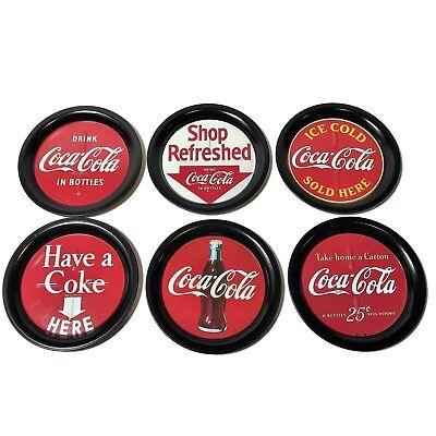 "1993 Coca Cola Coasters Round Metal 3 1/2"" Set of 6 with Coke Designs"