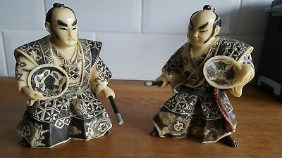 Pair Of Resin Oriental Figures Holding Rods