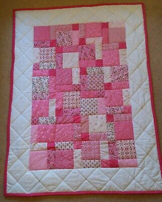 Handmade baby girl pink and white quilt with florals, hearts and spots.