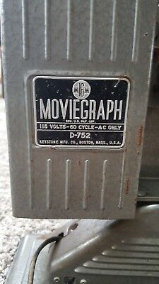 antique movie projector and movies