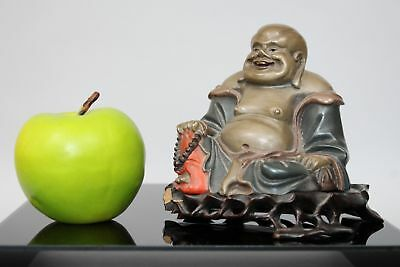 An antique Chinese Fuzhou Foochow laquer figure of a buddha on stand