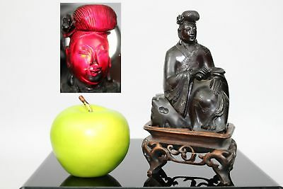 An antique Chinese cherry amber bakelite 'Faturan' figure of a lady on stand