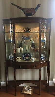 Simmonds and Simmonds Edwardian walnut-veneer glass fronted display cabinet