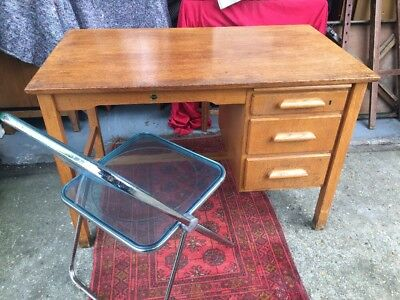 A good antique solid small oak desk Art Deco.