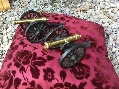 2 antique Cast iron & Brass Cannons .