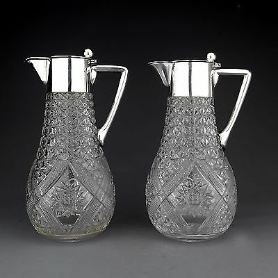 PAIR ANTIQUE GERMAN SOLID SILVER AND CUT GLASS CLARET JUGS / WINE EWERS c.1910