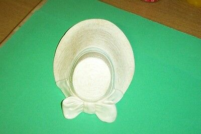 Art deco bonnet wall pocket