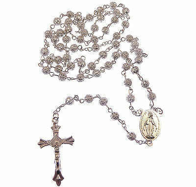 Silver metal decorative filigree rosary beads Miraculous and Sacred heart centre