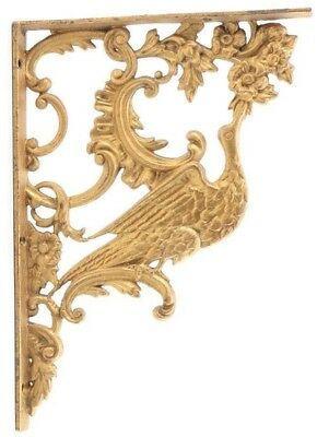 Elaborate Victorian gold painted cast iron bird motif corbel