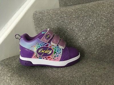 Girls heeleys. Size 11. Worn only once.