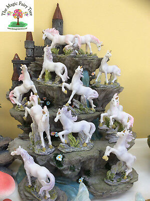 Set of 12 miniature unicorn figurines on mountain display unicorns fairy garden
