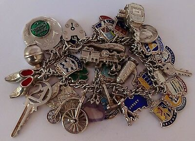 Fantastic vintage solid silver charm bracelet & 34 wonderful silver charms