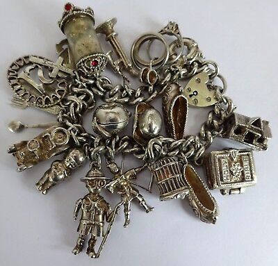 Beautiful vintage solid silver charm bracelet & 17 silver charms,open,move,rare
