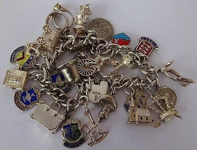 Gorgeous vintage solid silver charm bracelet & 25 wonderful silver charms