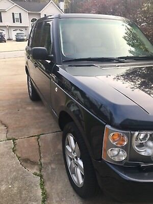 2003 Land Rover Range Rover Sport  Land Rover Sport HSE no rips or tears in seats, just a seat cover