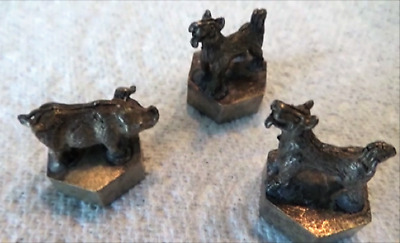 A Set of Chinese/Tibetan Cast Metal Gaming Pieces - A Boar and Two Hounds