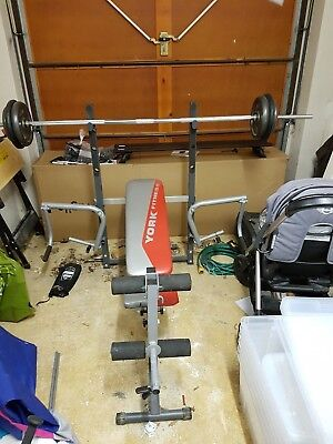 York Folding Weight Bench, Leg and Butterfly with 50Kg Cast Iron Plates and Bar