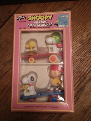 Vintage Snoopy and Friend on Skateboard Toys. New condition. Aviva Toy Company.