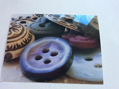Glossy photographs of Buttons for design ideas in art embroidery work
