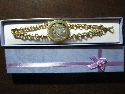 18 KT yellow gold bracelet and coin. Atocha coin is grade 1