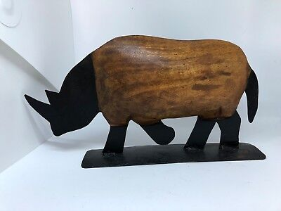 Hand carved hand made wood and black metal Rhinoceros