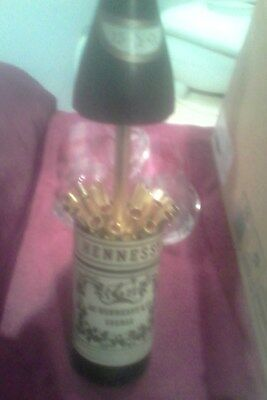old hennessey cognac display bottle (cigarette dispenser and lighter)