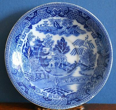 A vintage 1920's Maling flow Blue Two Temples Willow Saucer