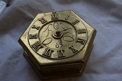 a nice brass table clock working