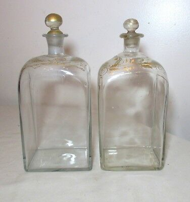 pair of antique hand blown 18th century gold gilded glass liquor decanter bottle