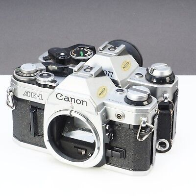 ~Lot of 2 Canon AE-1 Camera Bodies For Parts or Repair (185)