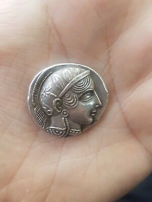 Ancient greek silver owl tetradrachm coin from Athens