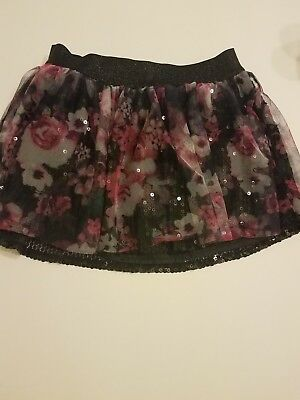 kid black sequin skirt , pink flowers, Justice, size 8 pre owned great condition