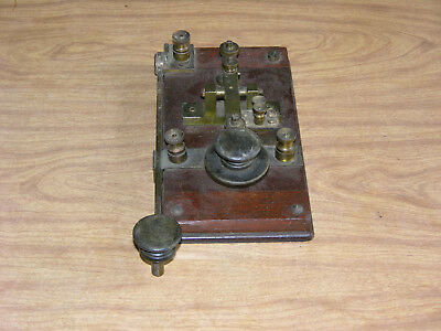 Old brass and oak telegraph key with knife switch