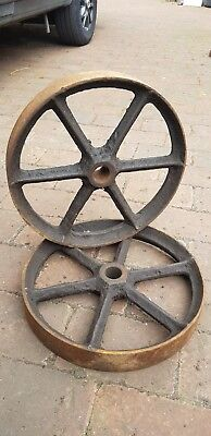 Matched Pair of Antique Cast Iron Wheels