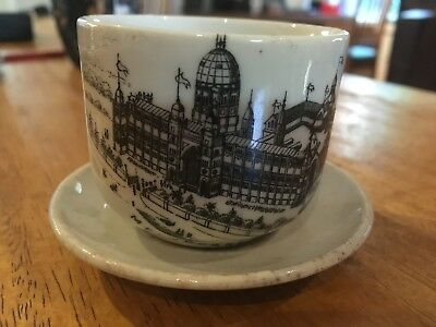 Very small cup & saucer, white with drawing of exhibition bulidings, 1888, good