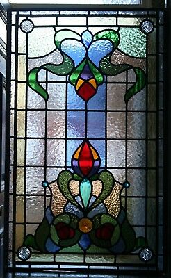 A beautiful traditional Victorian floral design stained glass panel
