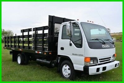 2000 Isuzu NPR Flatbed Truck Stake Side. LOW RESERVE Stock#15781
