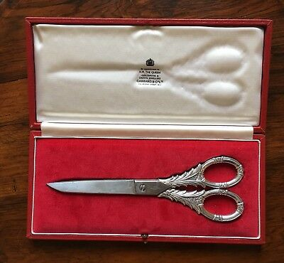 PAIR OF SILVER HANDLED SCISSORS by Goldsmiths and Silversmiths Co, London, 1981