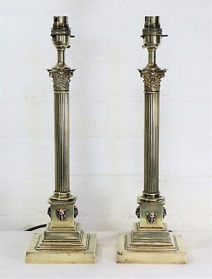 A Pair of Antique Corinthian Column Brass Table Lamps with Demonic Detailing