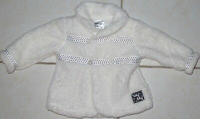 adorable Unisex white fluffy jacket with navy spot trim size 00 as new