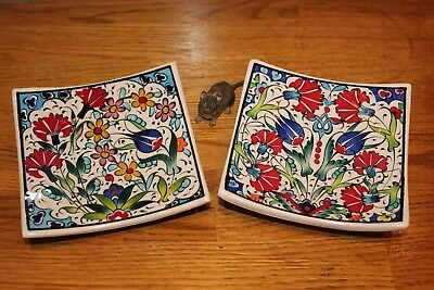 Two small hanging plates in the Turkish Iznik style, hand painted