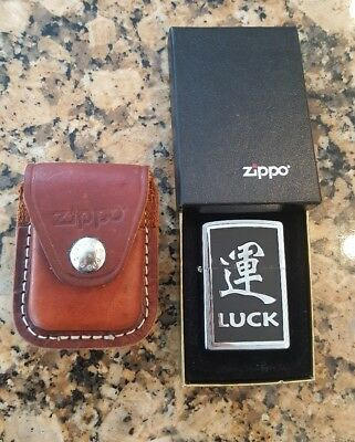 Zippo Lighter Luck Made In the USA and a brown leather pouch with clip