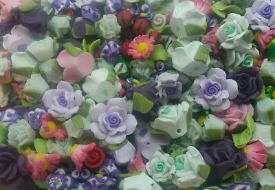 JOB LOT OF 60 MIXED COLOURED POLYMER CLAY FLOWERS and LEAVES  UK SELLER