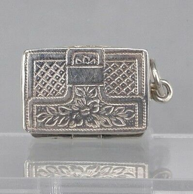 silver miniature vinaigrette form of a purse marked Sterling