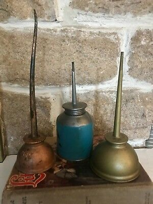 3 Vintage Oiler Oil Cans. 2 eagle brand made in USA and one turquoise Oiler.